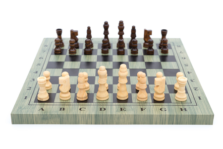 outwit: chess board with chess pieces on white with the white ones in front Stock Photo