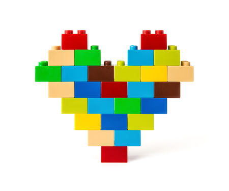 constructional: Heart made from colorful toy bricks on white