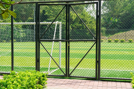 sequester: soccer field being locked with padlock