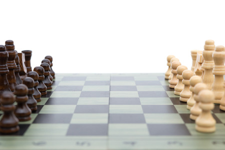 outwit: chess board with chess pieces on white