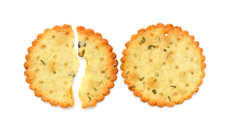 irresistible: top view broken and intact crispy crackers on a white background Stock Photo
