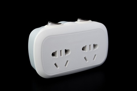 sockets: white power sockets with switiches on black background