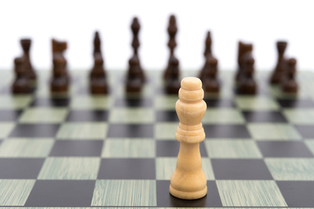 business symbols metaphors: chess board with the white King faces to the black ones