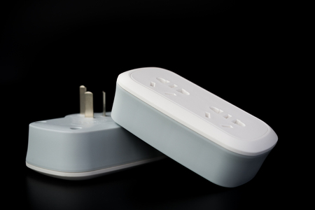 mains: two white power sockets with switiches on black background Stock Photo