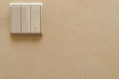 switches: electrical switches on a wall Stock Photo