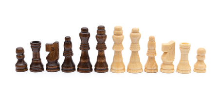 business symbols metaphors: black and brown chesses line up on a white background Stock Photo