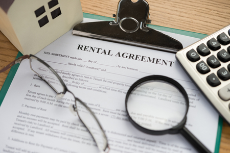 architectural model: rental agreement contact with an architectural model and a calculator and glasses and magnifier