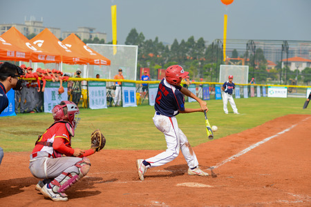 ZHONGSHAN PANDA CUP, ZHONGSHAN, GUANGDONG - October 28:unknown batter hitting the ball during a match of 2016 National Baseball Championship of Panda Cup on October 28, 2016. Editorial