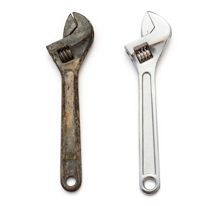 contrastive: a rusty and a good wrenches on white background