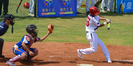 ZHONGSHAN, GUANGDONG,China - October 27:unknown batter about to miss the ball in a baseball game on October 27, 2016.