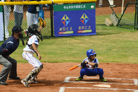 foul: ZHONGSHAN, GUANGDONG,China - October 27:unknown catcher about to catch a foul ball in a baseball game on October 27, 2016. Editorial
