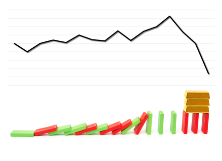 monetary concept: gold bars standing on falling dominos with a falling chart on background as a monetary concept
