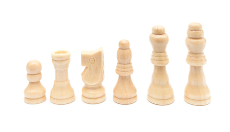 white chesses line up on a white background