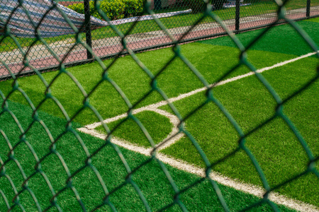 sequester: corner of a soccer field behind the fence