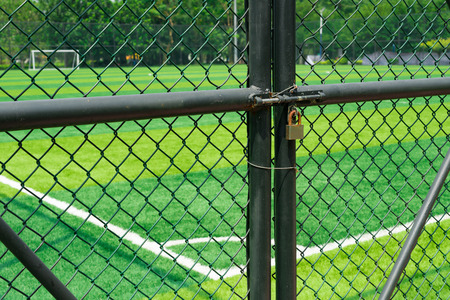 restraint: soccer field being locked with padlock