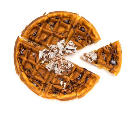 foodies: top view round waffle with one piece taking out on a white background