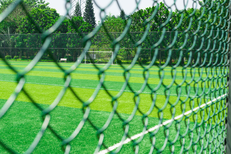 sequester: a soccer field behind the fence Stock Photo