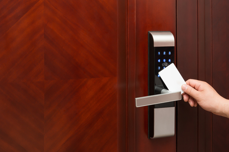 cardkey: electronic door lock opening by an blank security card good for adding text and logo Stock Photo