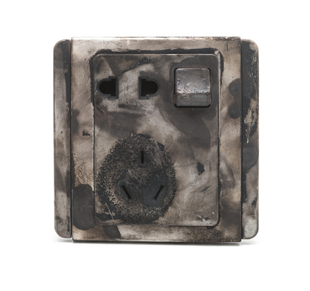 burnt out: burnt out electric socket close up on a white background