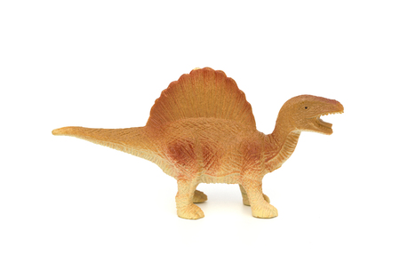 side view brown spinosaurus toy on a white background Stock Photo