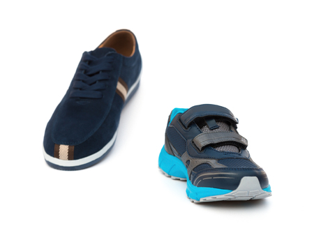 shoes for men and kids on white background family concept