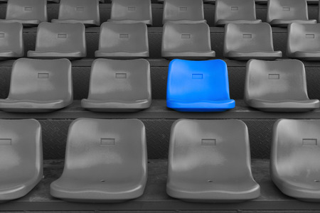 sequential: stadium seats with one highlighted on blue