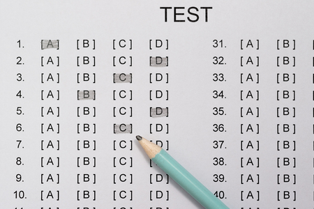 test score sheet with answers and pencil close up Banco de Imagens
