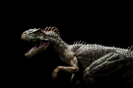 allosaurus on a dark background