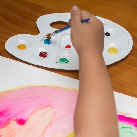 creating: kid doing colorful painting