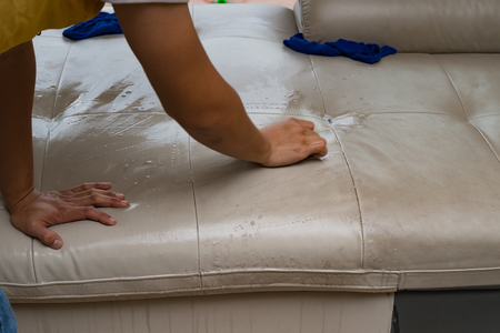 dirty room: house service of cleaning leather sofa