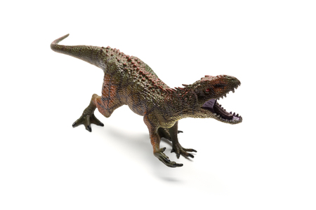 Carcharodontosaurus toy on a white background