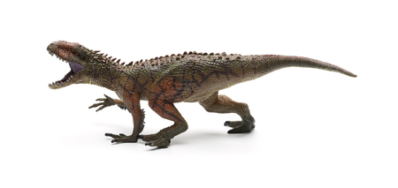 sidve view Carcharodontosaurus toy on a white background