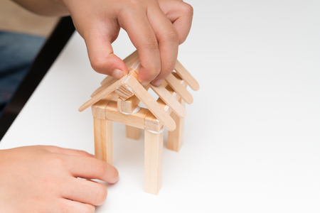 modular home: kid making a house model at home