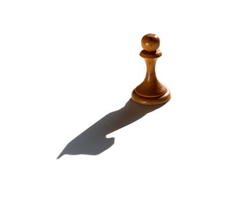 a chess pawn casting a knight piece shadow concept of strength and aspirations