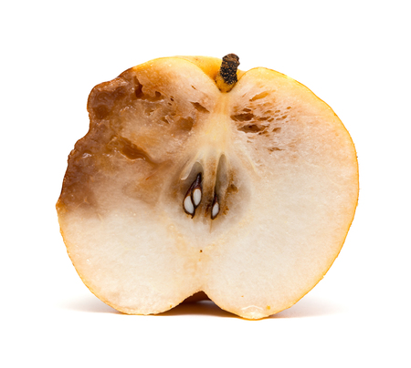half of a cut out rotten pear on white background