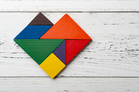 wooden tangram in a heart shape with copy space photo
