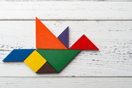 wooden tangram in a pigeon shape