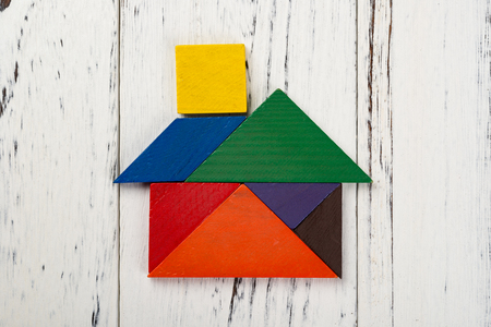 wooden tangram in a house shape Stock Photo