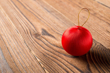 red christmas ball on a wood background Stock Photo
