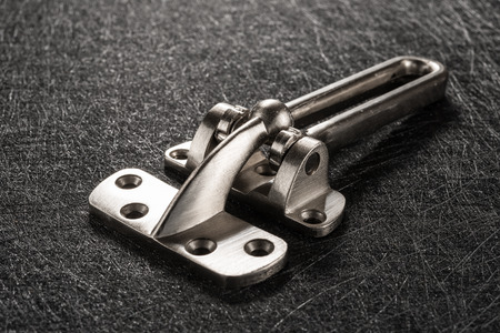 studio shoot of side view stainless steel safety latch opened