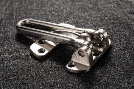 studio shoot of side view stainless steel safety latch closed