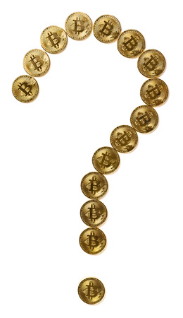 bitcoins shaped like a question mark with clipping path concept of uncertain future of crypto currency Stock Photo