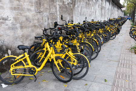 ZHONGSHAN;GUANGDONG;China-Mar 4;2018:shared bikes put aside the road.Too many shared bikes in China and quite some of them have been abandoned. Editorial