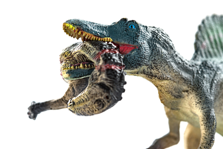 spinosaurus  biting a dinosaur body with blood on white close up Stock Photo