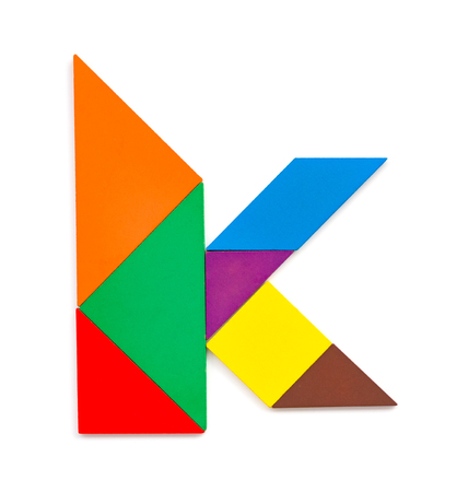 tangram shaped like a letter K on white background