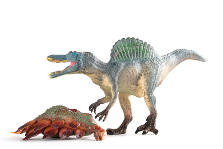 spinosaurus with a stegosaurus body nearby on white background