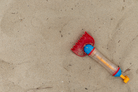 toy shovel on sand with copy space