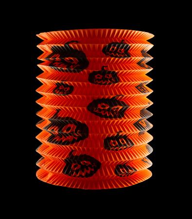paper lantern of halloween pumpkin on black