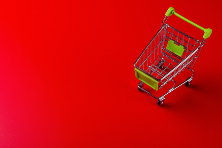 empty shopping cart on red background