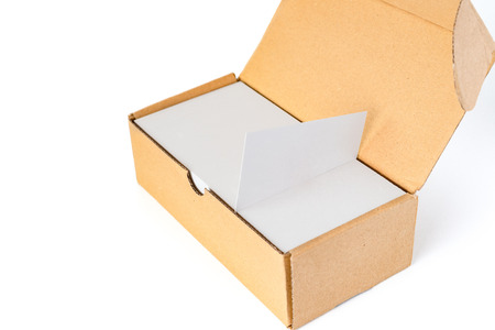 box of business cards with a blank one good for text and logo stands on top on white